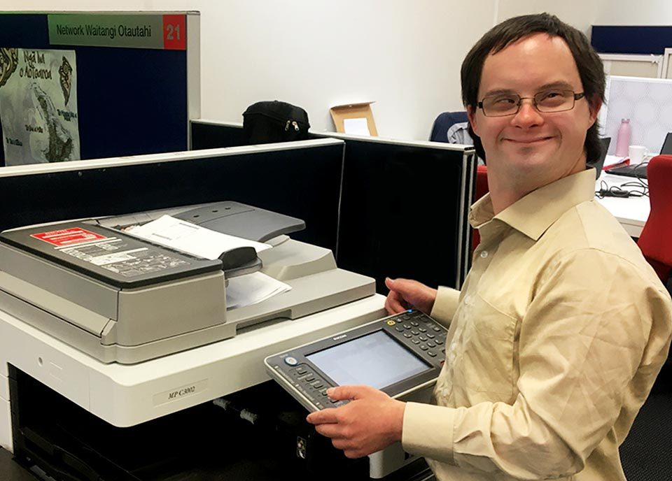 Andrew standing by the photocopier